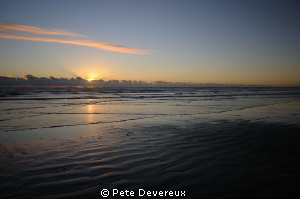Sunset over Ninety Mile Beach, NZ by Pete Devereux 